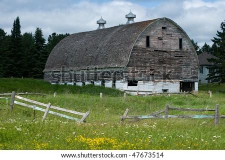 weather beaten white wooden barn near Hinkley Minnesota - stock photo