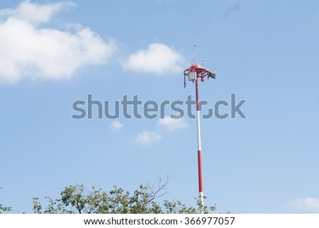 Weather in airport antennas, Devices meteorological station on the blue background of the sky - stock photo