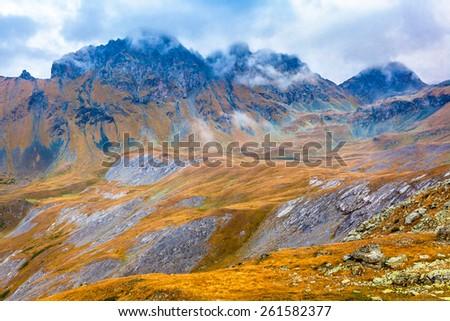 Weather in the mountains. Picture was taken during trekking hike in majestic and scenic mountains of northern Caucasia at autumn, Arhiz region, Abishira-Ahuba range, Karachay-Cherkessia, Russia - stock photo