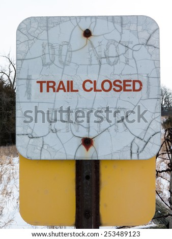Weather-stained sign 'Trail closed' - stock photo