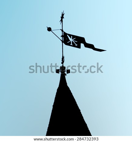 Weather vane with a flag and an emblem, standing on one of the European medieval fortresses - stock photo