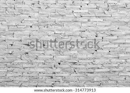 Weather worn brick wall interior pattern decoration vintage style black and white version - stock photo