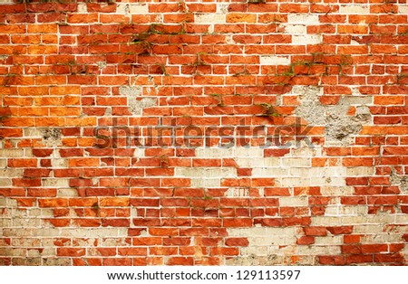 Weathered and cracked red Faux used brick wall - stock photo