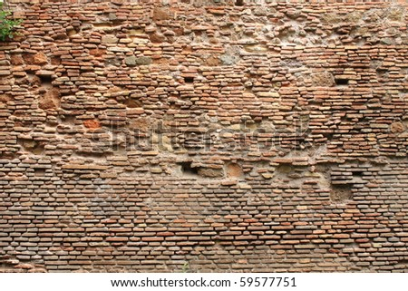 Weathered and old red brick wall - stock photo
