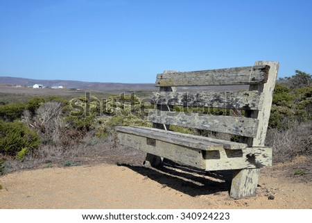 weathered bench in the California countryside - stock photo