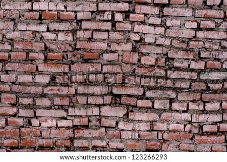 Weathered brick wall - stock photo