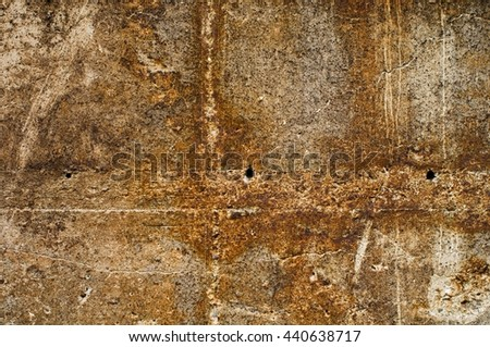weathered concrete surface with rusty iron elements - stock photo