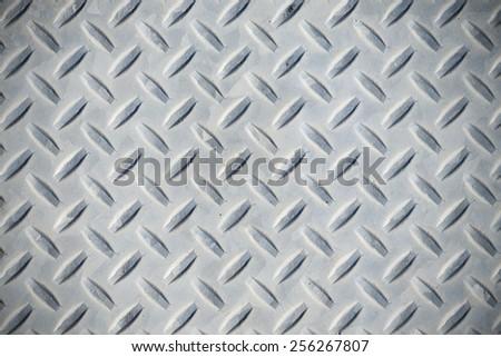 Weathered diamond plate background - stock photo