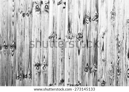 Weathered fence panels as a background image in black and white - stock photo