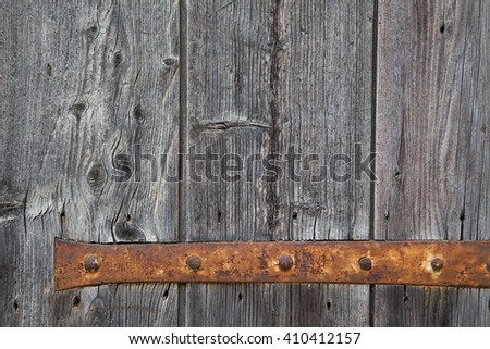 Weathered grey window with his rusty hinge - stock photo
