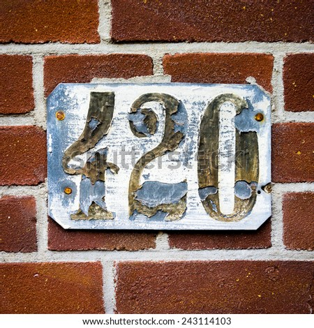 weathered house number four hundred and twenty - stock photo
