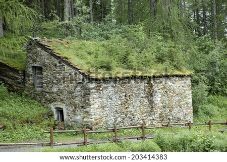 Weathered mountain house - stock photo