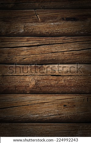 Weathered obsolete cracked wooden logs retro grunge background - stock photo