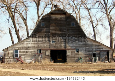 weathered old farm buildings gray barn - stock photo