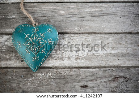 Weathered old wooden background with blue heart. Copy Space  - stock photo