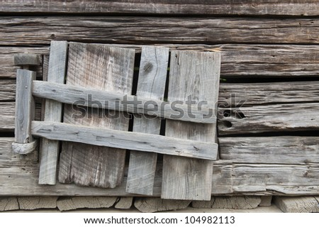 Weathered old wooden shutters window in abandoned barn in Great Smoky National Park - stock photo