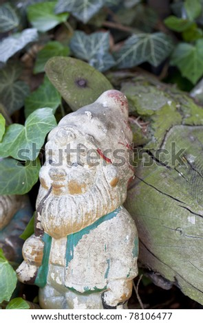 weathered retro garden decoration with garden gnomes - stock photo