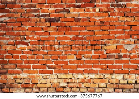Weathered stained old red brick wall background - stock photo