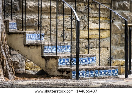 Weathered Stairway on the San Antonio, TX Riverwalk with colorful blue tile inlays - stock photo