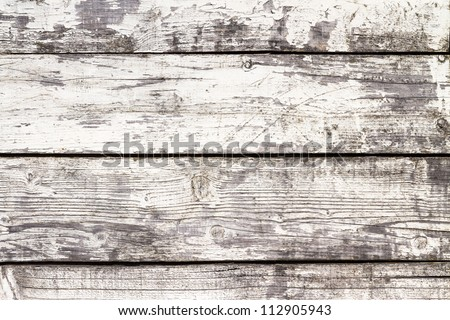 Weathered white painted wooden boards - stock photo