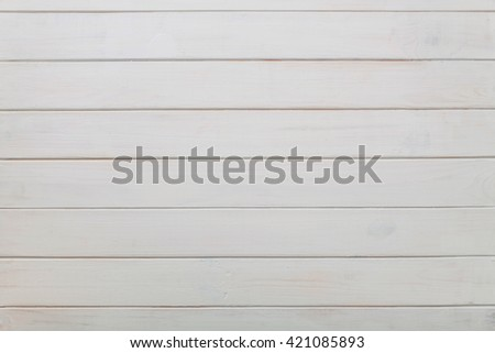 Weathered white wood background with knots and nail holes. - stock photo