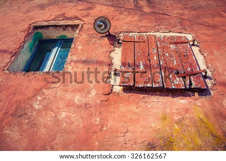 Weathered  window of old  abandoned stone cottage - stock photo
