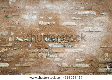 weathered with water stains ancient brick wall fragment from Venice, Italy - stock photo