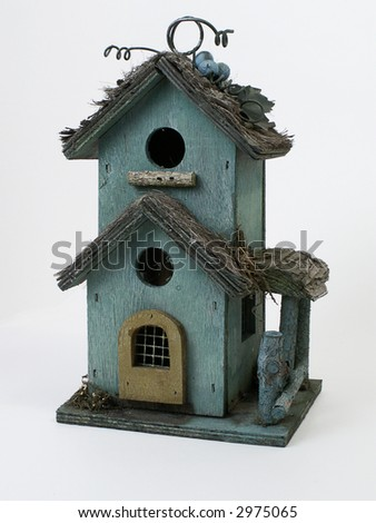 Weathered wooden birdhouse, isolated on white background. - stock photo