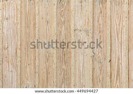 Weathered wooden boardwalk in the sand with some raindrops - stock photo