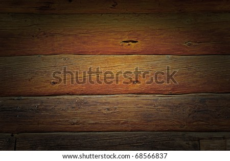 Weathered wooden logs wall of rural house grunge background - stock photo