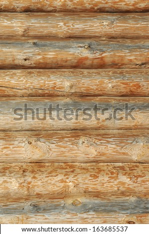 Weathered wooden logs with natural pattern closeup background - stock photo