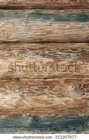 Weathered wooden logs with natural pattern closeup vintage background - stock photo