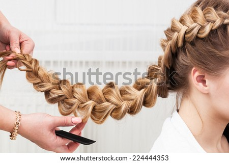 weave braid girl in a hair salon - stock photo