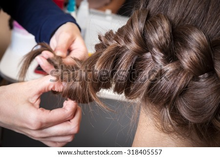 weave braids in the barber shop - stock photo