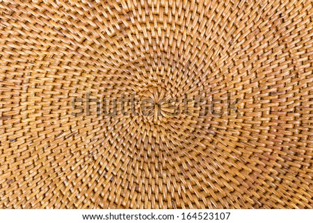 Weave pattern rattan background.Woven rattan with natural patterns are made by handmade - stock photo