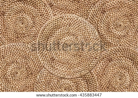 Weave rattan texture background, arranging layers of tradition woven round tray, texture background - stock photo