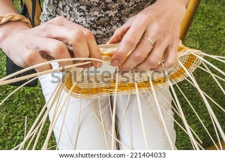 Weaving a wicker basket by handmade - stock photo