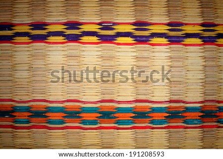 weaving colorful palm leaves mats - stock photo