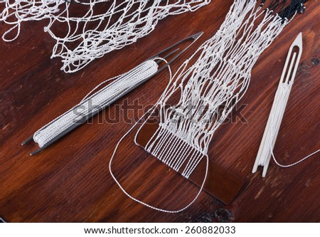 Weaving fishing nets. Handmade crafts at home - stock photo