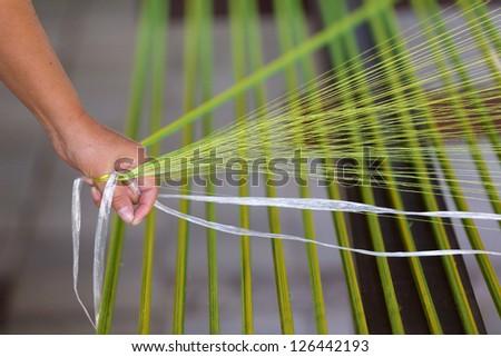 Weaving silk - stock photo