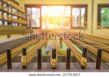 weaving thread for the textile industry. - stock photo