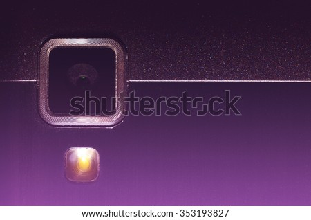 Web camera and flash your mobile phone. Close up view fragment metal back cover device. Instagram filter. Retro style toning. - stock photo