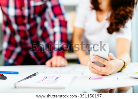 web designers developing mobile application framework - stock photo