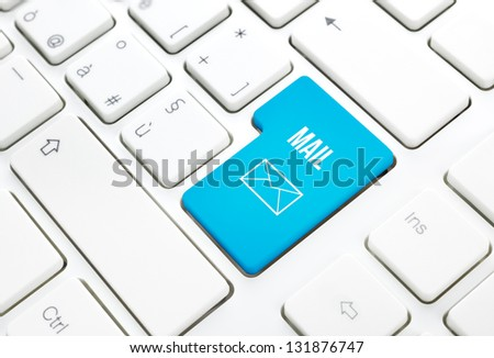 Web Mail network business concept, blue enter button or key on white keyboard photography. - stock photo