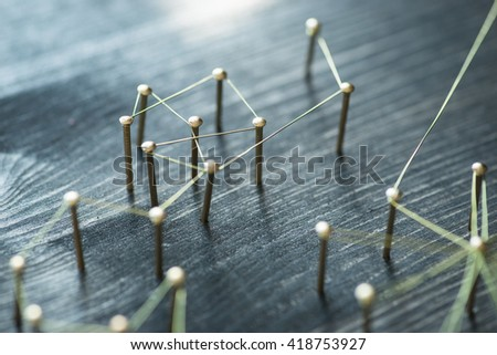 Web of wires, showing connections between groups and individuals - stock photo