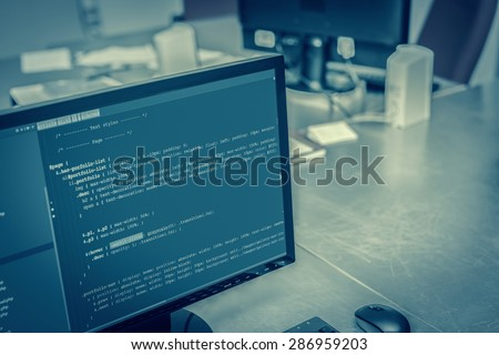 Web site codes on computer monitor at office - stock photo