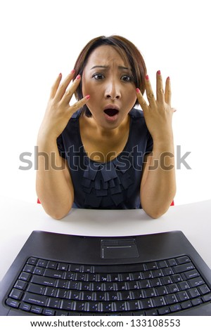 Webcam View.  Young Asian female on a computer viewed from the webcam's point of view. - stock photo