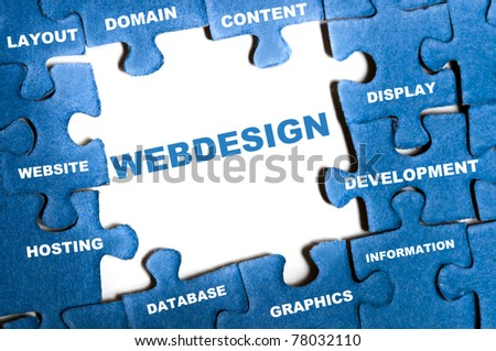Webdesign blue puzzle pieces assembled - stock photo