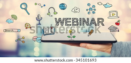 Webinar concept with man holding a tablet computer - stock photo