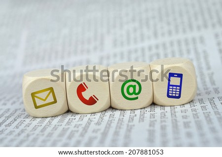 Website and Internet contact us page concept with colored icons on a newspaper  - stock photo